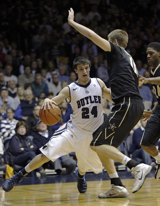 Butler's Kellen Dunham (24) goes to the basket against Vanderbilt's Josh Henderson during the first half of an NCAA college basketball game Tuesday, Nov. 19, 2013, in Indianapolis. (AP Photo/Darron Cummings)