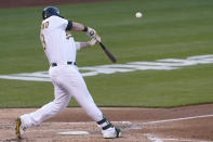 Oakland Athletics' Mitch Moreland hits a two-run home run against the Toronto Blue Jays during the second inning of a baseball game in Oakland, Calif., Tuesday, May 4, 2021. (AP Photo/Jeff Chiu)