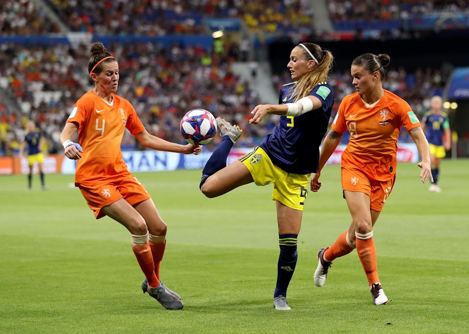 Kosovare Asllani of Sweden is challenged by Merel Van Dongen of the Netherlands and Sherida Spitse of the Netherlands during the 2019 FIFA Women's World Cup France Semi Final match between Netherlands and Sweden at Stade de Lyon on July 03, 2019 in Lyon, France. (Photo by Maja Hitij/Getty Images)