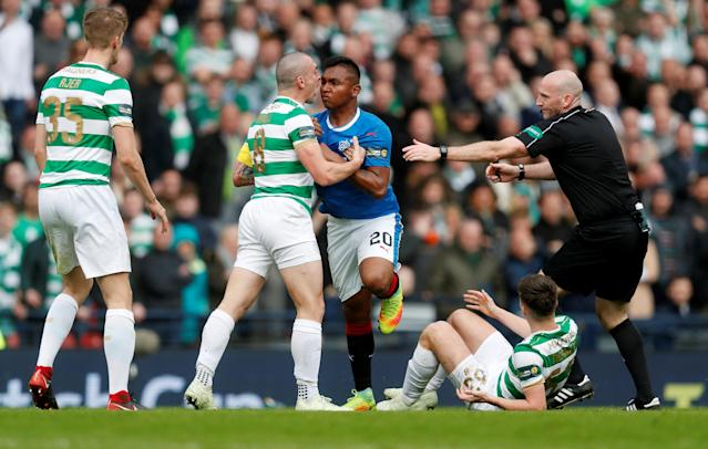 Soccer Football - Scottish Cup Semi Final - Celtic vs Rangers - Hampden Park, Glasgow, Britain - April 15, 2018 Rangers' Alfredo Morelos clashes with Celtic's Scott Brown as referee Bobby Madden attempts to intervene REUTERS/Russell Cheyne