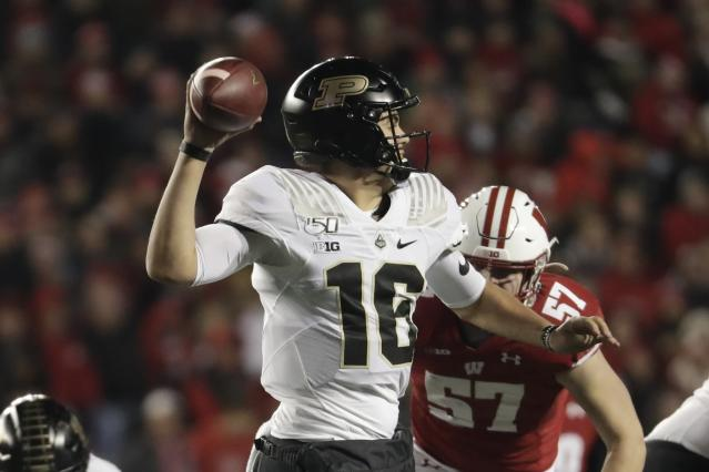 Purdue's Aidan O'Connell throws during the second half of an NCAA college football game against Wisconsin Saturday, Nov. 23, 2019, in Madison, Wis. (AP Photo/Morry Gash)