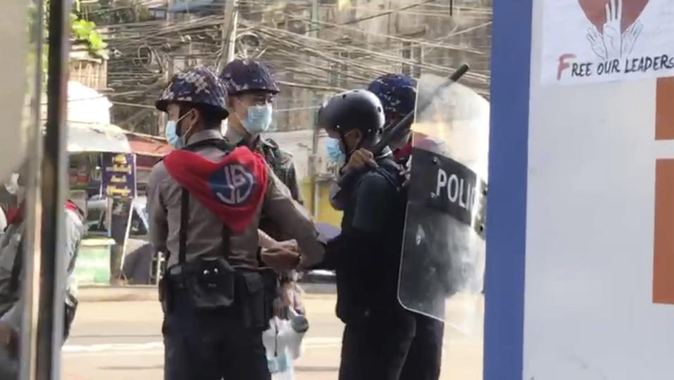 FILE - In this file image made from video taken on Feb. 27, 2021, Associated Press journalist Thein Zaw is arrested by police in Yangon, Myanmar. The government has detained dozens of journalists since the Feb. 1 coup, including Thein Zaw of The Associated Press. But local media are fighting back using other methods to provide news updates, such as social media platforms. (AP Photo/File)