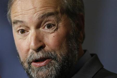 NDP leader Mulcair speaks during a news conference on Parliament Hill in Ottawa