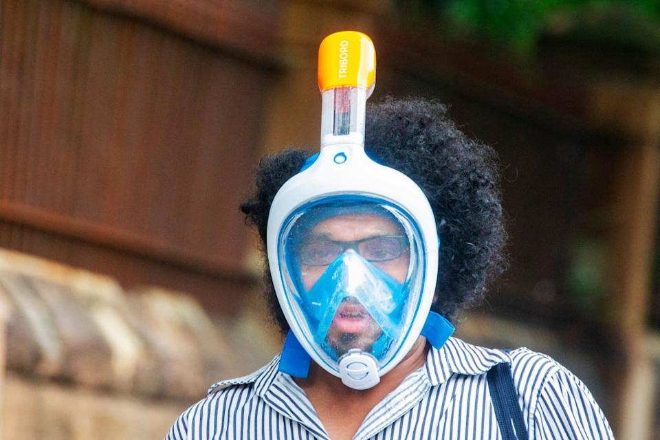 A person wearing a snorkel and mask when the pandemic was in its first wave in March. Source: Getty Images