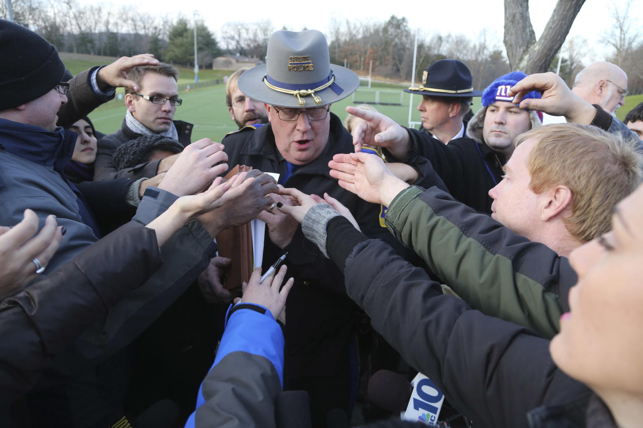 "Lt. J. Paul Vance of the Connecticut State Police is surrounded by reporters as he hands out the list of victims of the shooting at the Sandy Hook Elementary School, Saturday, Dec. 15, 2012 in Sandy Hook village of Newtown, Conn. The victims of the shooting were shot multiple times by semiautomatic rifle, according to Connecticut Chief Medical Examiner H. Wayne Carver II, M.D. Carver called the injuries ""devastating"" and the worst he and colleagues had ever seen. Police began releasing the identities of the dead. All of the 20 children killed were 6 or 7 years old. Carver, said he examined seven of the children killed, and two had been shot at close range. When asked how many bullets were fired, he said, ""I'm lucky if I can tell you how many I found."" (AP Photo/Mary Altaffer)"