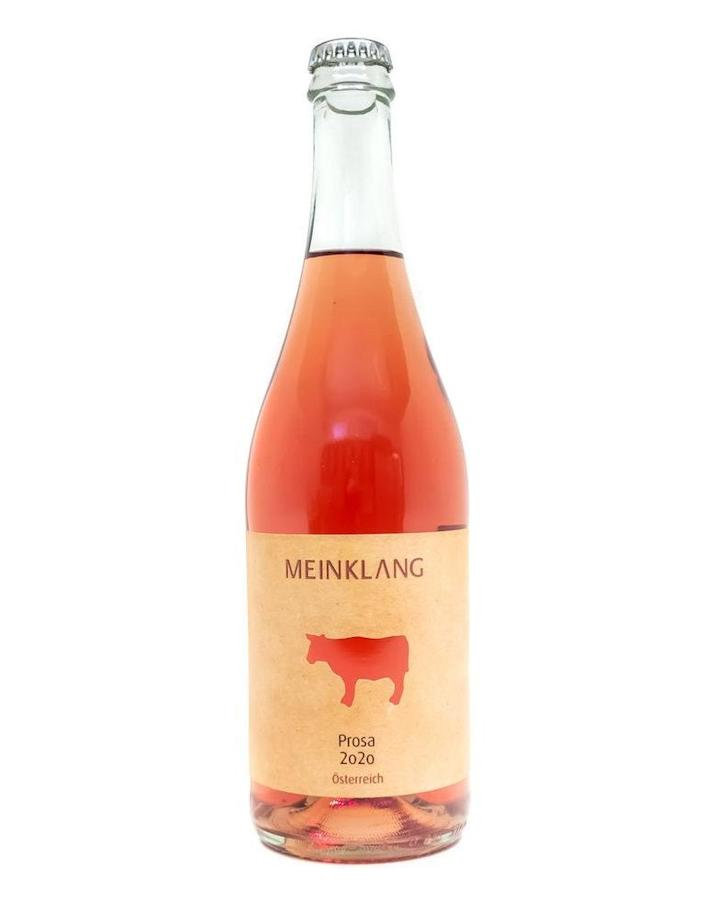 """If the word rosé is synonymous with the South of France to you, you're in for a surprise with Meinklang's Prosa Pet Nat. Made from a blend of Blaufränkisch, Pinot Noir, and Zweigelt grapes, this rose is produced in the Burgenland region of Austria, on the border of the Hungarian lowlands. This biodynamic, unrefined, and unfiltered wine pairs well with spicy, vibrant foods (<a href=""""https://primalwine.com/collections/rose-wine-natural-biodynamic-organic/products/prosa-pet-nat-meinklang-austria-natural-wine"""" rel=""""nofollow noopener"""" target=""""_blank"""" data-ylk=""""slk:Primal Wine"""" class=""""link rapid-noclick-resp"""">Primal Wine</a> suggests tacos, and we're inclined to agree). $19, Artisan Wine Shop. <a href=""""https://www.artisanwineshop.com/meinklang-prosa-sparkling-rose-pinot-noir-2020.html"""" rel=""""nofollow noopener"""" target=""""_blank"""" data-ylk=""""slk:Get it now!"""" class=""""link rapid-noclick-resp"""">Get it now!</a>"""