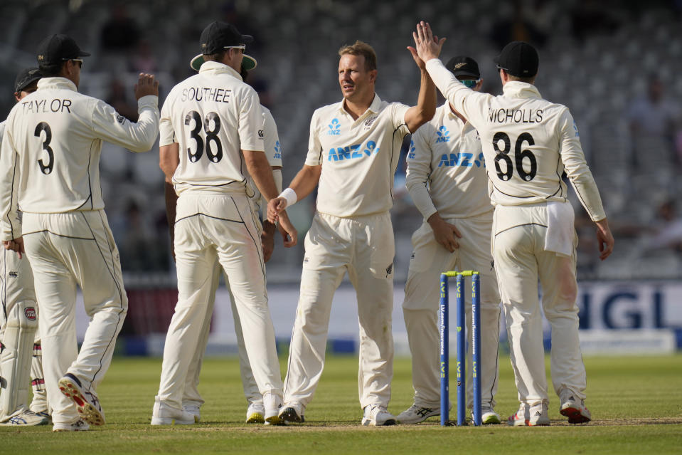New Zealand's Neil Wagner celebrates taking the wicket of England's Joe Root during the fifth day of the Test match between England and New Zealand at Lord's cricket ground in London, Sunday, June 6, 2021. (AP Photo/Kirsty Wigglesworth)