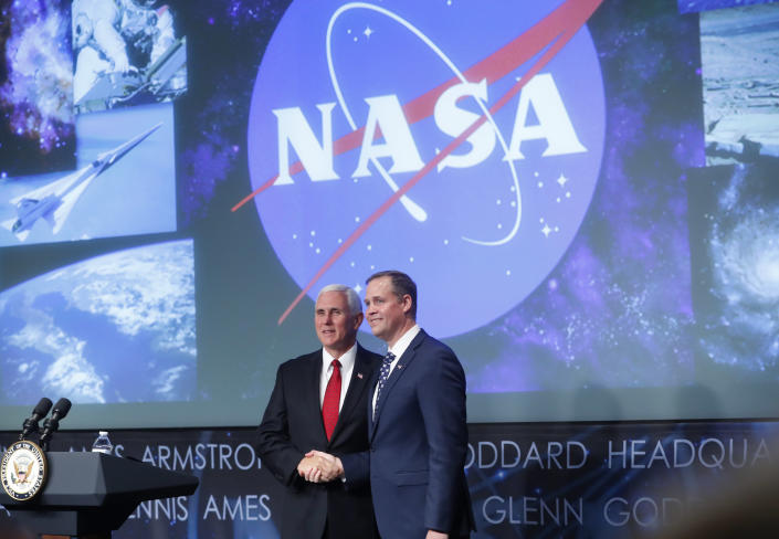 Vice President Mike Pence shakes hands with Bridenstine during a swearing-in ceremony in April 2018 at NASA headquarters in Washington. (Photo: Pablo Martinez Monsivais/AP)