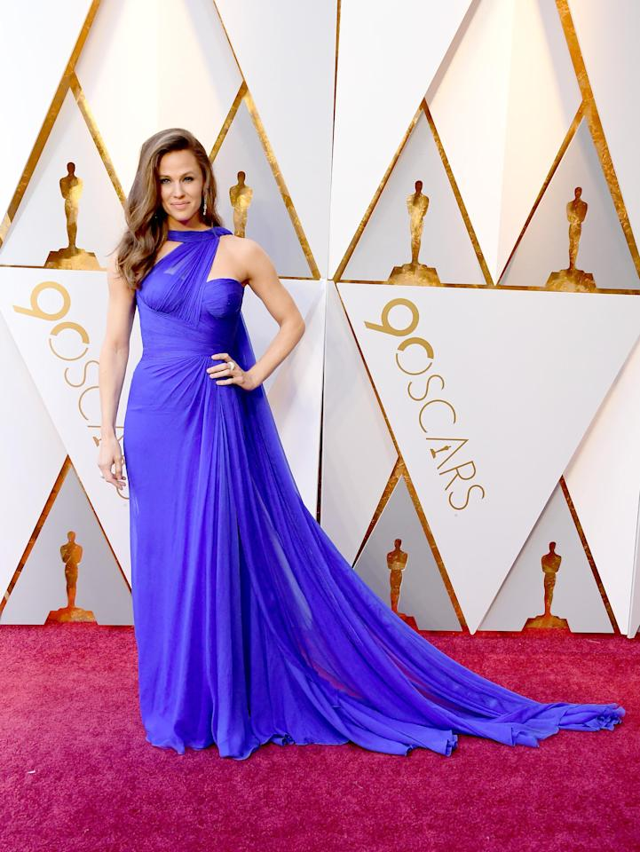 <p>Jennifer Garner wears a grecian-style sheer electric-blue gown. She brings serious Hollywood glam to the red carpet.</p>