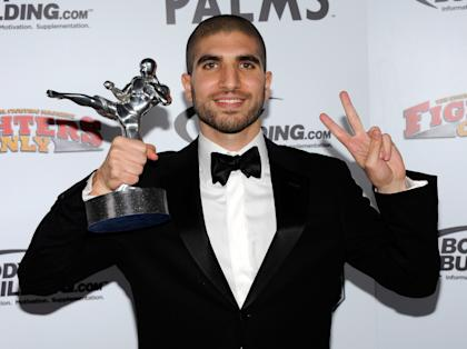 Ariel Helwani holds the MMA Journalist of the Year award at a 2011 event in Las Vegas. (Getty)