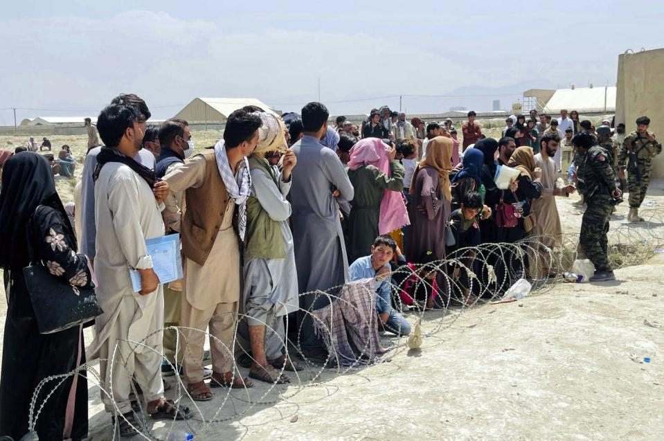 """<span class=""""caption"""">Hundreds of people who want to flee the country gathered outside the international airport in Kabul, Afghanistan, Aug. 17, 2021</span> <span class=""""attribution""""><a class=""""link rapid-noclick-resp"""" href=""""https://newsroom.ap.org/detail/Afghanistan/f2192ca9885b46aaa4e31e3ce835576d/photo?Query=crowds%20airport%20kabul&mediaType=photo&sortBy=arrivaldatetime:desc&dateRange=Anytime&totalCount=158&currentItemNo=143"""" rel=""""nofollow noopener"""" target=""""_blank"""" data-ylk=""""slk:AP photo"""">AP photo</a></span>"""
