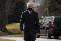 President Joe Biden walks over to speak with reporters before boarding Marine One to visit wounded troops at Walter Reed National Military Medical Center, on the South Lawn of the White House, Friday, Jan. 29, 2021, in Washington. (AP Photo/Evan Vucci)