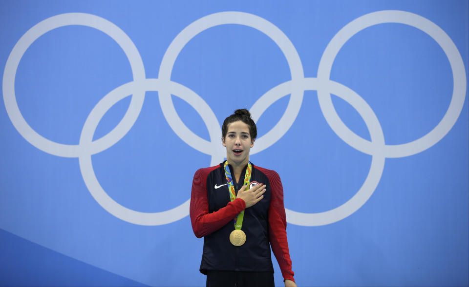 FILE - In this Aug. 12, 2016 file photo, United States' Maya DiRado celebrates with her gold medal during the women's 200-meter backstroke medals ceremony during the swimming competitions at the 2016 Summer Olympics in Rio de Janeiro, Brazil. A debate is fomenting between former gold medalist DiRado and some American swimmers over Michael Andrew's decision not to be vaccinated against the COVID-19 virus on the eve of competition at the Tokyo Olympics. (AP Photo/Michael Sohn, File)