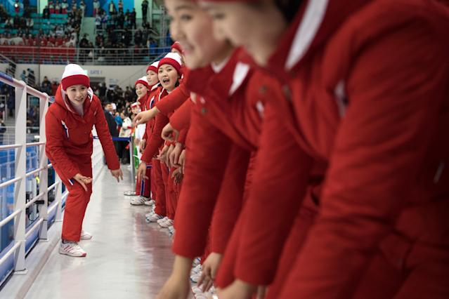 <p>North Korean cheerleaders perform during the Women's Ice Hockey Preliminary Round, Group B match between North Korea and Switzerland on day one of the PyeongChang 2018 Winter Olympic Games at Kwandong Hockey Centre on February 10, 2018 in Gangneung, South Korea. (Photo by Carl Court/Getty Images) </p>