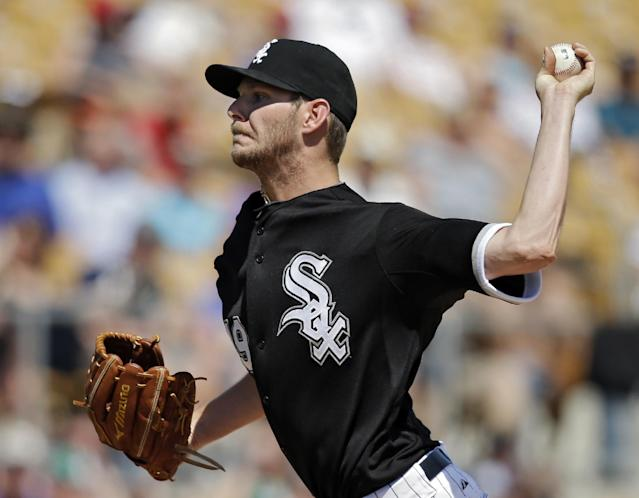 Chicago White Sox starting pitcher Chris Sale delivers against the Colorado Rockies in the third inning of a spring exhibition baseball game Tuesday, March 25, 2014, in Glendale, Ariz. (AP Photo/Mark Duncan)
