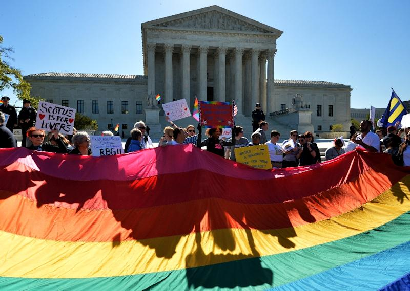 Supporters of same-sex marriage gather outside the US Supreme Court waiting for its decision on April 28, 2014 in Washington, DC (AFP Photo/Mladen Antonov)