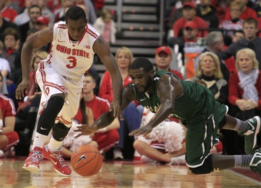 Ohio State's Shannon Scott, left, and Chicago State's Quinton Pippen chase a loose ball during the first half of an NCAA college basketball game on Saturday, Dec. 29, 2012, in Columbus, Ohio. (AP Photo/Jay LaPrete)