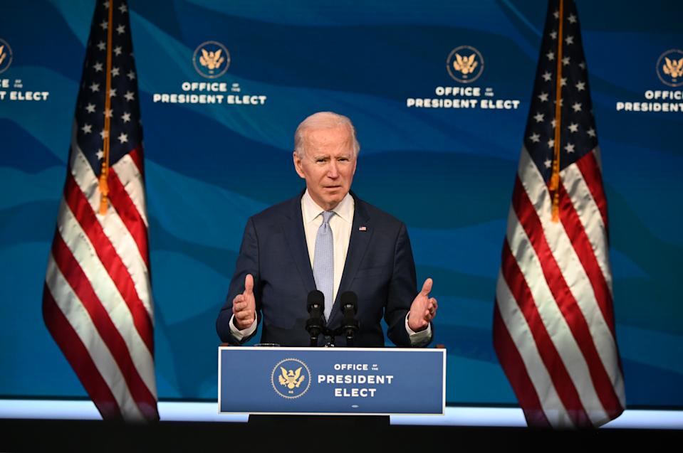 US President-elect Joe Biden speaks at the Queen Theater on January 6, 2021, in Wilmington, Delaware. - US Vice President Mike Pence, in defiance of President Donald Trump, said Wednesday that he will not intervene to stop the certification by Congress of Democrat Joe Biden's election victory. (Photo by JIM WATSON / AFP)
