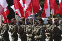 Polish soldiers hold national flags as Poland marks the centennial of the Battle of Warsaw, a Polish military victory in 2020 that stopped the Russian Bolshevik march toward the west, in Warsaw, Poland, Saturday Aug. 15, 2020. U.S. Secretary of State Mike Pompeo attended as he wrapped up a visit to central Europe.(AP Photo/Czarek Sokolowski)
