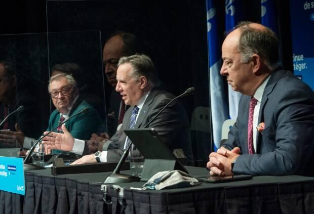 Quebec Health Director Horacio Arruda, left, Quebec Premier François Legault  and Health Minister Christian Dubé, right, at a news conference in Montreal on Wednesday. (Ryan Remiorz/The Canadian Press - image credit)