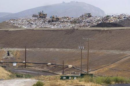 Bulldozers move trash atop of a 300-feet tall hill at the Simi Valley Landfill and Recycling Center in Simi Valley, California May 8, 2008.   REUTERS / Hector Mata