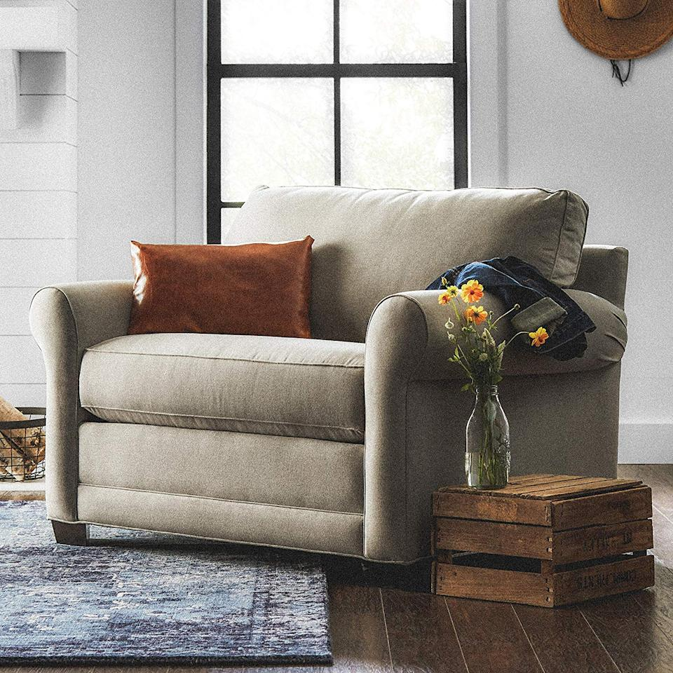"""<h3><a href=""""https://www.amazon.com/Stone-Beam-Kristin-Modern-Sleeper/dp/B073ZNVNLL/ref=sr_1_3"""" rel=""""nofollow noopener"""" target=""""_blank"""" data-ylk=""""slk:Stone & Beam Chair & A Half Sleeper Sofa"""" class=""""link rapid-noclick-resp"""">Stone & Beam Chair & A Half Sleeper Sofa</a> </h3><br>Not quite a sofa, not quite an armchair — this plush, small-space seating solution from one of Amazon's exclusive home brands also wields makeshift guest room powers with its pull-out sleeper sofa capabilities.<br><br><strong>Stone & Beam</strong> Chair-and-a-Half Upholstered Sleeper Sofa, $, available at <a href=""""https://www.amazon.com/Stone-Beam-Kristin-Modern-Sleeper/dp/B073ZPDT1R/ref=sr_1_3"""" rel=""""nofollow noopener"""" target=""""_blank"""" data-ylk=""""slk:Amazon"""" class=""""link rapid-noclick-resp"""">Amazon</a>"""