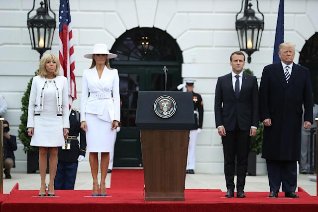 The first lady's hat stole the show as she posed with her husband and the Macrons. (Photo: Mark Wilson/Getty Images)