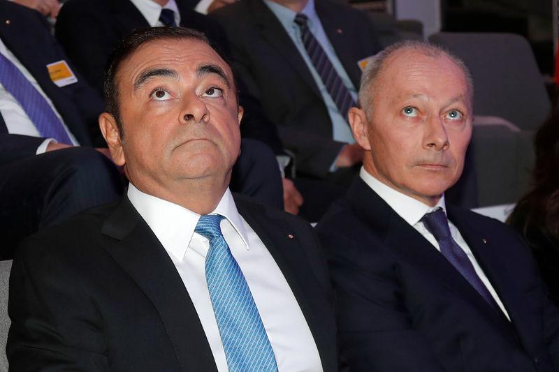 Carlos Ghosn, Chairman and CEO of the Renault-Nissan Alliance and Groupe Renault chief competitive officer Thierry Bollore attend a news conference to unveil Renault next mid-term strategic plan in Paris
