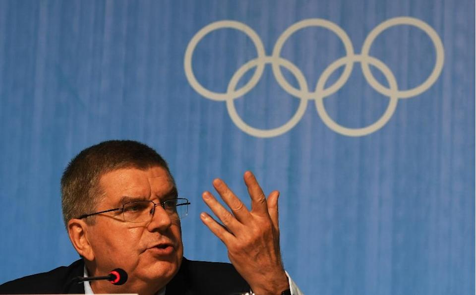 IOC president Thomas Bach insists that the doping scandal won't taint the Rio Games (AFP Photo/Roberto Schmidt)