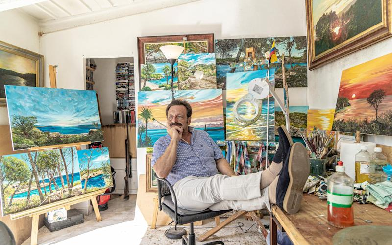 Roberto Escobar surrounded by his paintings at home in Majorca last month - Bruno Daureo