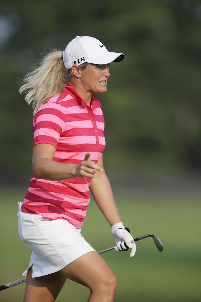 Suzann Pettersen, of Noway, tries coaxing the ball on the 17th green during the third round of the Meijer LPGA Classic golf tournament at Blythefield Country Club, Saturday, Aug. 9, 2014, in Belmont, Mich. (AP Photo/Carlos Osorio)