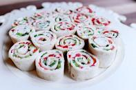 """<p>Your kids will love these tortilla bites. They're made with cream cheese and red and green peppers.</p><p><strong><a href=""""https://www.thepioneerwoman.com/food-cooking/recipes/a11934/christmas-tortilla-rollups/"""" rel=""""nofollow noopener"""" target=""""_blank"""" data-ylk=""""slk:Get the recipe."""" class=""""link rapid-noclick-resp"""">Get the recipe.</a></strong></p><p><strong><a class=""""link rapid-noclick-resp"""" href=""""https://go.redirectingat.com?id=74968X1596630&url=https%3A%2F%2Fwww.walmart.com%2Fsearch%2F%3Fquery%3Dpioneer%2Bwoman%2Bknives&sref=https%3A%2F%2Fwww.thepioneerwoman.com%2Ffood-cooking%2Fmeals-menus%2Fg34272733%2Fchristmas-party-appetizers%2F"""" rel=""""nofollow noopener"""" target=""""_blank"""" data-ylk=""""slk:SHOP KNIVES"""">SHOP KNIVES</a><br></strong></p>"""