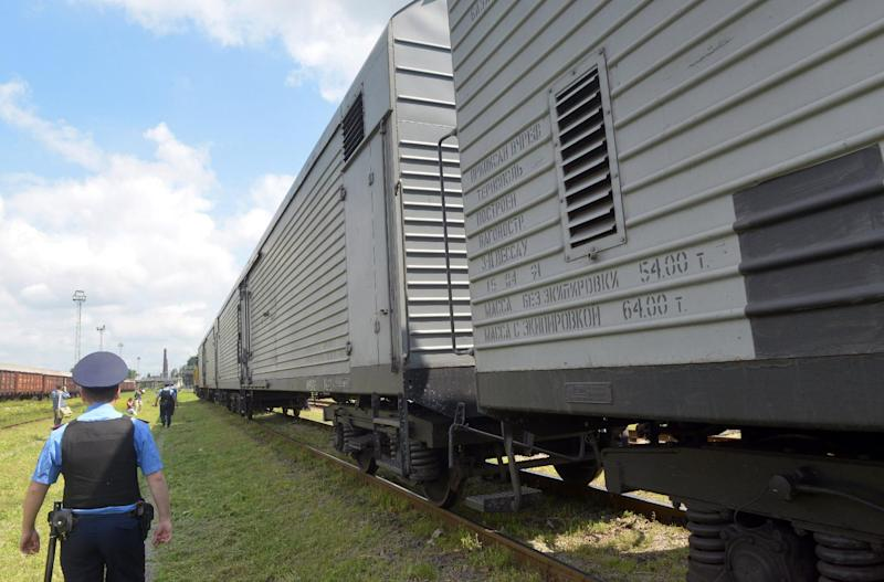 The train carrying the bodies recovered from the downed Malaysian flight MH17 arrives at the Malyshev Tank Plant in the government-held Ukrainian city of Kharkiv on July 22, 2014, from the eastern Ukrainian city of Donetsk