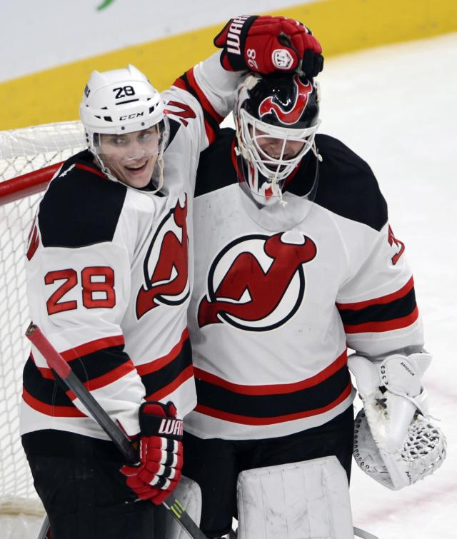 New Jersey Devils goalie Martin Brodeur (30) gets a hug from teammate Anton Volchenkov after defeating the Montreal Canadiens 4-1 in National Hockey League action, Tuesday, Jan. 14, 2014, in Montreal. (AP Photo/The Canadian Press, Ryan Remiorz)