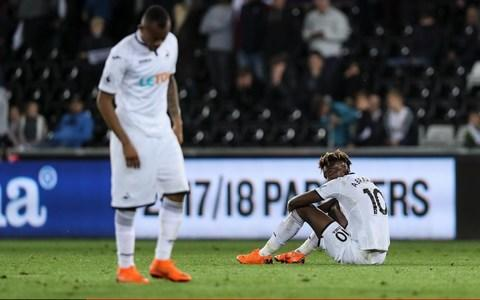 Carlos Carvalhal is set to leave Swansea after failing in his Premier League survival mission. With Swansea's relegation to the Championship all but confirmed, Carvalhal is heading for the exit after a dreadful run of form and huge question marks over his tactics and mindset. The former Sheffield Wednesday manager provided an initial impact following his appointment in December - taking 17 points from his first nine games - yet a poor run of nine games without a win will force his departure after Sunday's match against Stoke City. Swansea initially appointed Carvalhal with one eye on his experience of the Championship but the club's board have now decided he is not the man to take them forward. His contract expires at the end of the season and an option to extend that deal will now not be triggered. Swansea's drop into the Championship is virtually guaranteed after Huddersfield's draw at Chelsea Credit: Getty Images Swansea's drop into the second tier is virtually guaranteed after Huddersfield's draw at Chelsea on Wednesday night. The Welsh club require a huge victory over Stoke and for Southampton to be heavily beaten by Manchester City on the final day, but it appears nigh on impossibe for Swansea to survive. It means Swansea will now be looking for their fifth manager in under 20 months - after sacking Paul Clement late last year they interviewed Aitor Karanka (now at Nottingham Forest) and Ostersunds' Graham Potter, but the club are expected to look at other options as they prepare for next season. There is also growing pressure on Swansea chairman Huw Jenkins, after a disastrous period defined by abysmal player recruitment. There could even be protests during Sunday's game against Stoke at the Liberty Stadium.