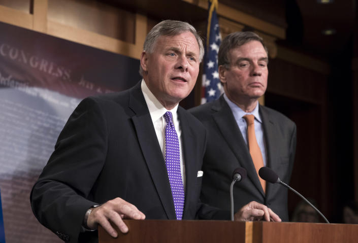 Senate Select Committee on Intelligence Chairman Richard Burr, R-N.C., left, and Vice Chairman Mark Warner, D-Va., update reporters on the status of their inquiry into Russian interference in the 2016 U.S. elections on Oct. 4. (Photo: J. Scott Applewhite/AP)