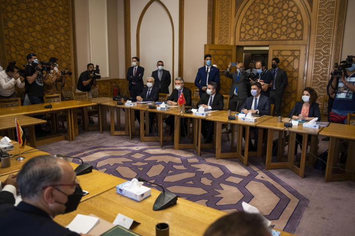 Turkish Foreign Ministry Deputy Sedat Onal, seated third right, meets with Hamdi Sanad Loza, Egyptian deputy foreign minister, and their delegations, at the foreign ministry in Cairo, Egypt, Wednesday, May 5, 2021. (AP Photo/Nariman El-Mofty)