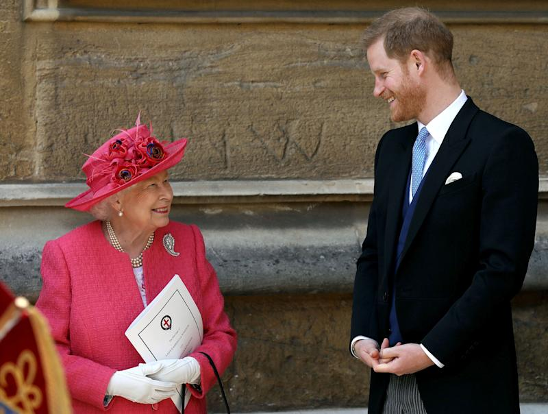 The Queen and Prince Harry share a joke at Lady Gabriella's wedding at her Windsor Castle wedding.
