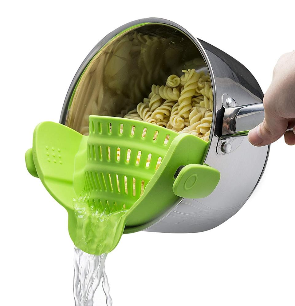 """No more scrambling for a strainer once your lentil pasta is done cooking — this clip-on colander makes draining your pasta a total breeze.<br><br><strong>Kitchen Gizmo</strong> Snap N Strain Strainer, Clip On Silicone Colander, $, available at <a href=""""https://amzn.to/2YDtO9r"""" rel=""""nofollow noopener"""" target=""""_blank"""" data-ylk=""""slk:Amazon"""" class=""""link rapid-noclick-resp"""">Amazon</a>"""