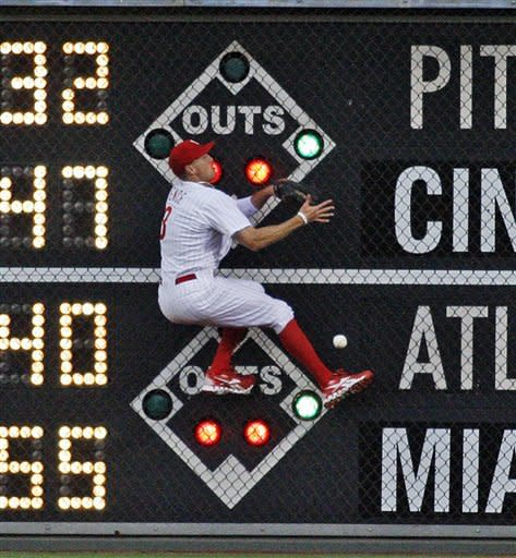Philadelphia Phillies' Hunter Pence cannot come down with a one-run triple by Los Angeles Dodgers' Tony Gwynn in the third inning of a baseball game, Wednesday, June 6, 2012, in Philadelphia. (AP Photo/H. Rumph Jr)