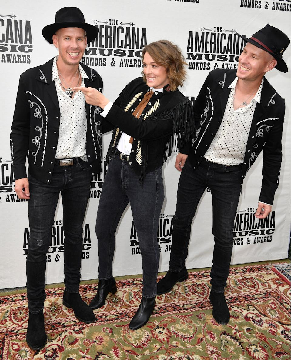 Brandi Carlile and The Twins on the red carpet at the Americana Music Honors & Awards on Wednesday.