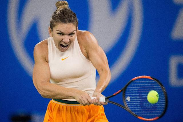 Simona Halep of Romania played two Grand Slam finals, winning the French Open crown, and won titles in Shenzhen and Montreal, leading the rankings for 40 weeks this year (AFP Photo/NICOLAS ASFOURI)