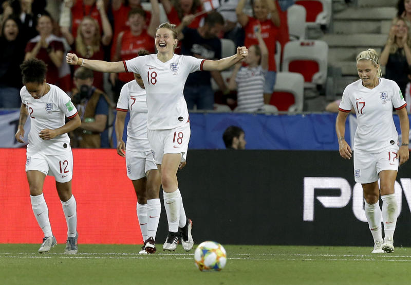 England's Ellen White, front, celebrates after scoring her side's second goal during the Women's World Cup Group D soccer match between Japan and England at the Stade de Nice in Nice, France, Wednesday, June 19, 2019. (AP Photo/Claude Paris)