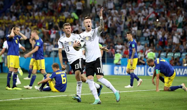 Soccer Football - World Cup - Group F - Germany vs Sweden - Fisht Stadium, Sochi, Russia - June 23, 2018 Germany's Marco Reus celebrates scoring their first goal with Thomas Muller as Sweden's Andreas Granqvist and team mates look dejected REUTERS/Francois Lenoir