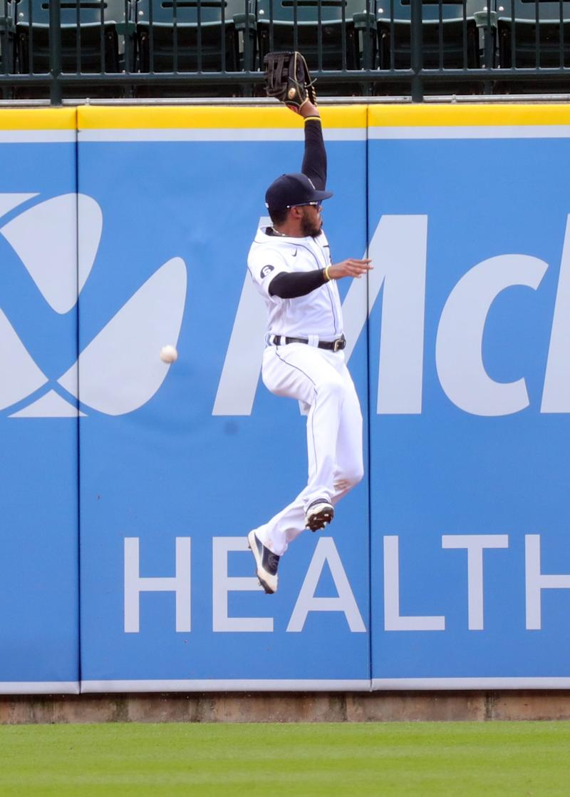 Detroit Tigers right fielder Harold Castro (30) makes an attempt to catch a fly ball during sixth-inning action against the Cleveland Indians at Comerica Park, Sunday, Aug. 16, 2020.