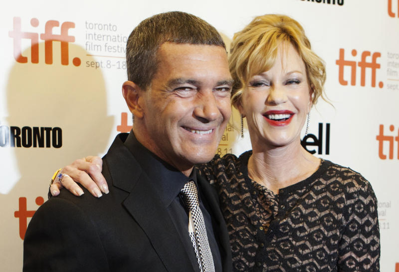 "Cast member Antonio Banderas and his wife actress Melanie Griffith arrive on the red carpet for the film ""The Skin I Live In"" during the 36th Toronto International Film Festival (TIFF) September 11, 2011. REUTERS/Mark Blinch (CANADA - Tags: ENTERTAINMENT)"
