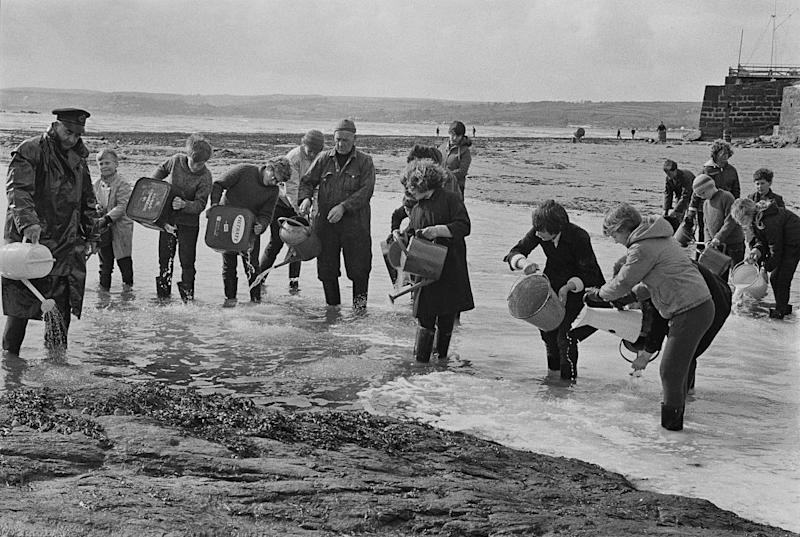 There was a swift community response to the spill, with volunteers racing to disperse the oil on the beach at Marazion: Getty