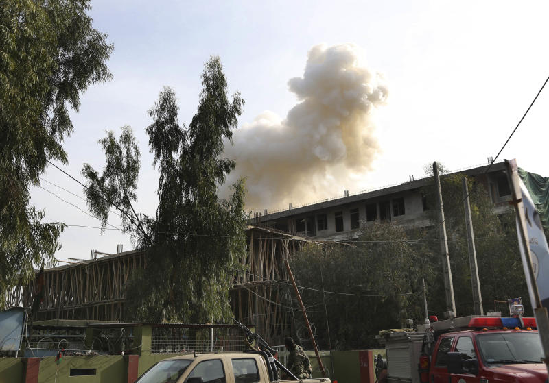 Smoke billows from a building after an attack on a police station in Jalalabad, the capital of eastern Nangarhar province, Afghanistan, Thursday, March 20, 2014. Taliban insurgents staged a multi-pronged attack on the police station, using a suicide bomber and gunmen to lay siege to the station, government officials said. Two remotely detonated bombs also exploded nearby. (AP Photo/Rahmat Gul)