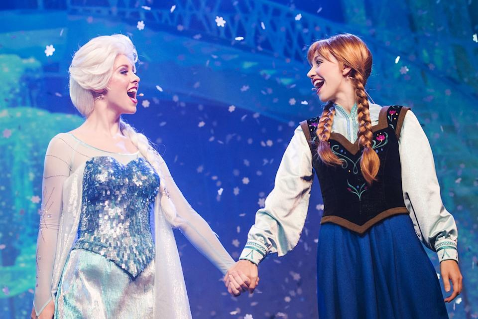 "Cast members as princesses Elsa and Anna in the ""Frozen Live"" show at Disney California Adventure."