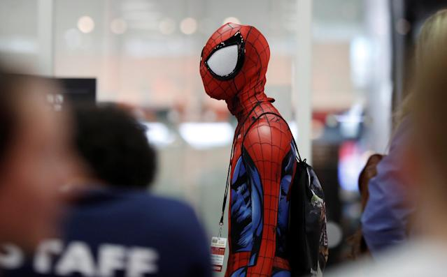 A visitor in costume walks past diners at the London Comic Con, at the ExCel exhibition centre in east London, Britain October 27, 2017. REUTERS/Peter Nicholls